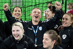 Andrea Seric, Tamara Mavsar, Tone Tiselj, head coach, Maja Son, Alja Jankovic and Kristina Bille  of Krim celebrate after the handball match between RK Krim Mercator and Larvik HK (NOR) of Women's EHF Champions League 2011/2012, on November 13, 2011 in Arena Stozice, Ljubljana, Slovenia. Larvik defeated Krim 22-19 but both teams qualified to new round. (Photo By Vid Ponikvar / Sportida.com)