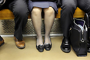 legs of male and female commuters Tokyo Japan