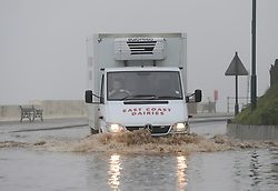 © Licensed to London News Pictures. 30/05/2013<br /> <br /> Saltburn, Cleveland, United Kingdom<br /> <br /> A van driver makes his way through deep floods as heavy overnight rain causes flooding in Saltburn on the A174 coast road near to the Ship Inn on the seafront in the town.<br /> <br /> Photo credit : Ian Forsyth/LNP