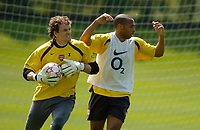 Photo: Richard Lane.<br />Arsenal Training Session. The Barclays Premiership. 11/05/2006.<br />Jens Lehmann claims the ball ahead of Thierry Henry during a training match.