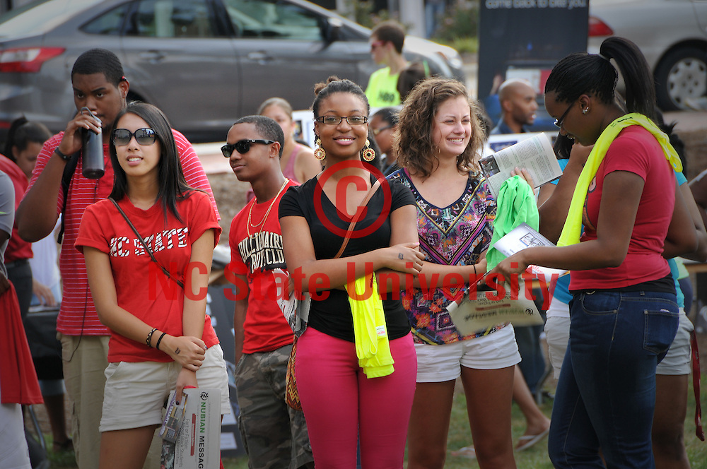 Students watch the entertainment on stage at the annual Back to School Jam on Harris Field.