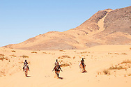 Africa; Namibia; Kaokoveld; Himba; Himba kids on donkeys