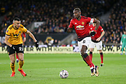 Manchester United Midfielder Paul Pogba battles with Wolverhampton Wanderers midfielder Romain Saiss (27) during the The FA Cup match between Wolverhampton Wanderers and Manchester United at Molineux, Wolverhampton, England on 16 March 2019.