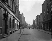 30/11/1952<br /> 11/30/1952<br /> 30 November 1952<br /> Dublin street scene. View down Liffey Street upper from junction of Henry Street and Mary Street. Image for Maurice L. Clifford Solicitors for accident case.
