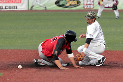 06 June 2014:  Kyle Bluestein & Ozney Guillen during a Frontier League Baseball game between the Frontier Freedom and the Normal CornBelters at Corn Crib Stadium on the campus of Heartland Community College in Normal Illinois