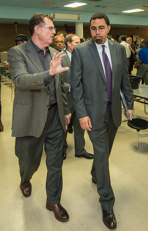 Houston ISD Superintendent Dr. Terry Grier, left, talks with Acting US Secretary of Education John King, right, during a visit the Apollo Market at Sharpstown High School, January 15, 2016.