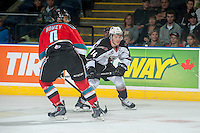KELOWNA, CANADA - NOVEMBER 8: Madison Bowey #4 of Kelowna Rockets checks Matt Bellerive #14 of Vancouver Giants on November 8, 2014 at Prospera Place in Kelowna, British Columbia, Canada.   (Photo by Marissa Baecker/Shoot the Breeze)  *** Local Caption *** Madison Bowey; Matt Bellerive;