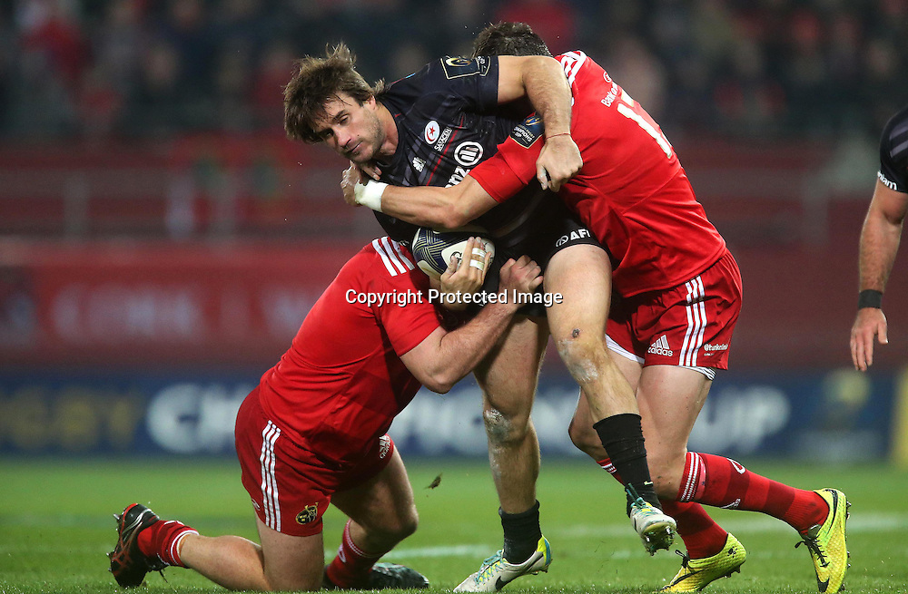 European Rugby Champions Cup Round 2, Thomond Park, Limerick 24/10/2014<br /> Munster vs Saracens<br /> Munster's James Cronin and Andrew Smith with Marcelo Bosch of Saracens<br /> Mandatory Credit &copy;INPHO/Ryan Byrne