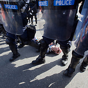 A protestor gets stepped on by riot police during a rally to protest Bradley Manning's imprisonment near Quantico Marine Corps base, March 20, 2011. More than two dozen people were arrested during the protest, including Daniel Ellsberg, a former military analyst. The arrests came at the end of a largely peaceful demonstration.