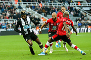 Moussa Djenepo (#12) of Southampton wins the ball from Allan Saint-Maximin (#10) of Newcastle United in the penalty box during the Premier League match between Newcastle United and Southampton at St. James's Park, Newcastle, England on 8 December 2019.