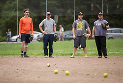 Ian Acredolo, from left, Casey Hellman, Jeremy Herman and Rob Teebay wait for ground balls during batting practice, as the Montclair softball league celebrates its 50th season, Saturday, April 22, 2017, at Montclair Park in Oakland, Calif. The pickup softball game, played every Saturday by a group of enthusiasts ranging in age from 20 to 75, started in 1968 in Berkeley and moved to Montclair about 25 years ago. (Photo by D. Ross Cameron)