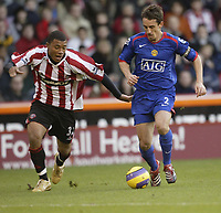 Photo: Aidan Ellis.<br /> Sheffield United v Manchester United. The Barclays Premiership. 18/11/2006.<br /> Sheffield's Colin Kazim Richards (L) and Manchester's Gary Neville