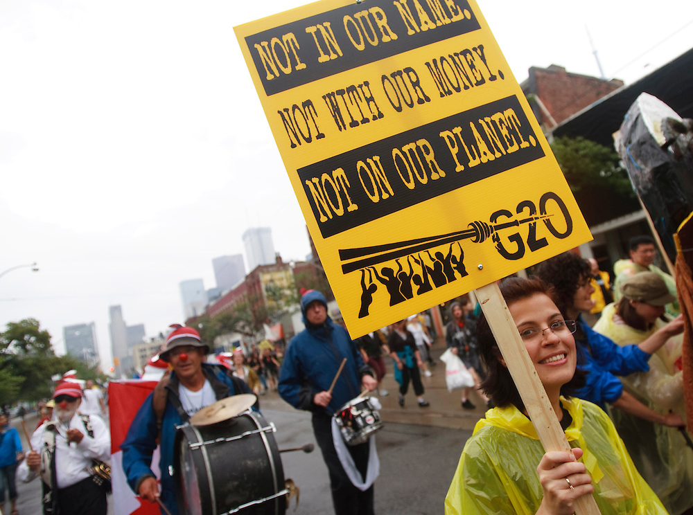 Demonstrators march through the streets of Toronto, Canada June 26, 2010 to protest the G20 summit which is being held in the city this weekend. The majority of the thousands of protestors were peaceful but a small contingent, know as the Black Block went on a destructive rampage through the city's core.<br /> AFP/GEOFF ROBINS/STR
