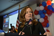 Garden City, New York, USA. November 6, 2018. Nassau County Democrats watch Election Day results at Garden City Hotel, Long Island. Congresswoman KATHLEEN RICE speaks at podium, after winning re-election as New York's Representative for Fourth Congressional District