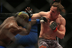 Saxon Delafield (Red) lands a punch on Sibusiso Mdoko (Blue) during the seventh bout of the Extreme Fighting Championships, EFC 52 held at the Grand West Casino in Cape Town, South Africa on the 5th August 2016<br /> <br /> Photo by:   Shaun Roy / Real Time Images