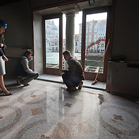 A member of staff check some work being carried out on the Grand Canal side of the Gritti Palace Hotel..Several major restoration works are being carried out in this period in Venice, the go to a complete refurbishment of the famous Gritti Palace Hotel, to transformation into a luxury VIP 7 stars hotel of XV century Palazzo Papadopoli to the restoration of the Church of the Gesuiti
