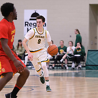 1st year guard Benjamin Hillis (8) of the Regina Cougars in action during the home game on January  27 at Centre for Kinesiology, Health and Sport. Credit: Arthur Ward/Arthur Images