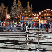 Concert goers line up to grab a local bus home from Jackson Hole Mountain Resort at the end of the #marchradness concert series in Wilson, Wyoming.