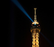 The top of the Eiffel Tower by Night. Paris, France