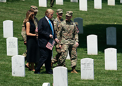 May 23, 2019 - Arlington, Virginia, U.S. - United States President Donald J. Trump and First Lady Melania Trump visit Arlington National Cemetery ahead of Memorial Day during the ''Flags-In'' ceremony, in Arlington, Virginia on May 23, 2019. ''Flags-In'' is an annual event where the 3rd U.S. Infantry Regiment, ''The Old Guard,'' places American flags at every gravesite at Arlington National Cemetery. .Credit: Kevin Dietsch / Pool via CNP (Credit Image: © Kevin Dietsch/CNP via ZUMA Wire)