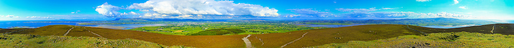 Near 360 degree view from Knocknarea Cairn shot at 35mm including, from left, Maguin's Island, Coney Island, Raghly beach, Drumcliff Bay, Slieve League cliffs in Donegal on the horizon, Rosse's Point, Benbulbin and the Dartry Mountains, Sligo Bay, Sligo, Rathcarrick/Knocknarra Forest (foreground), Lough Gill, Killerry Mountain, Ballysadare, Ballysadare Bay, Slieve Gamph/The Ox Mountains and the South-West Co. Sligo coast on to Killala Bay on the horizon