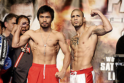 Nov 13, 2009; Las Vegas, NV, USA; Manny Pacquiao (l) and Miguel Cotto (r) at the weigh-in for their 12 round bout at the MGM Grand Garden Arena in Las Vegas, Nevada.  Mandatory Credit: Ed Mulholland