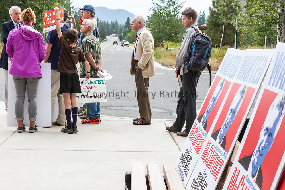California's 4th district Congressman, TOM MCCLINTOCK, talks with a handful of protesters/constituents who waited for him to exit a Contractors Association of Truckee Tahoe (CATT) at the Truckee Tahoe Airport in Truckee, California, on Tuesday, August 22, 2017. MCCLINTOCK spent several minutes after his CATT meeting answering questions and engaging in conversation with several of the remaining protesters.<br /> <br /> Approximately 50-60 protesters had been in attendance before the meeting waiting to speak with the congressman. According to several local-area residents on site, they have requested a town hall meeting with McClintock for approximately two years without luck. Protester Paco Lindsay said that their protest was &quot;in no way a reflection at all on CATT.&quot;