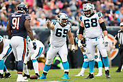 CHICAGO, IL - OCTOBER 22:  Tyler Larsen #69 and Andrew Norwell #68 of the Carolina Panthers figure out who to block during a game against the Chicago Bears at Soldier Field on October 22, 2017 in Chicago, Illinois.  The Bears defeated the Panthers 17-3.  (Photo by Wesley Hitt/Getty Images) *** Local Caption *** Tyler Larsen; Andrew Norwell