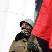 KIEV, UKRAINE - February 22, 2014: A member of the Maidan defence group takes guard at the main entrance of the Ukrainian parliament building in Kiev. CREDIT: Paulo Nunes dos Santos