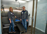 Bethany Stockman and Bruce Varnum in their new dog washing room at the Laconia Pet Center on Union Avenue in Laconia.  (Karen Bobotas/for the Laconia Daily Sun)