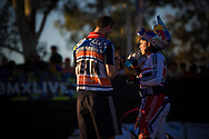 # 12 (READE Shanaze) GBR has a chat with her coach at the UCI BMX Supercross World Cup in Santiago del Estero, Argintina.