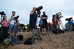 """© Licensed to London News Pictures. 27/07/2018. LONDON, UK.  Large numbers of people gather on Primrose Hill to witness the lunar eclipse, known as a """"Blood Moon"""", over the capital.  Unfortunately, low cloud prevented them seeing this century's longest lunar eclipse.  Photo credit: Stephen Chung/LNP"""