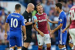 Mark Noble of West Ham United laughs as Oscar of Chelsea is booked - Rogan Thomson/JMP - 15/08/2016 - FOOTBALL - Stamford Bridge Stadium - London, England - Chelsea v West Ham United - Premier League Opening Weekend.