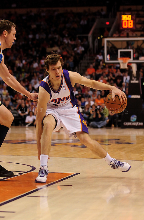 Mar. 14 2010; Phoenix, AZ, USA; Phoenix Suns guard Goran Dragic (2) dribbles the ball in the second half at the US Airways Center. The Suns defeat the Hornets 120 to 106. Mandatory Credit: Jennifer Stewart-US PRESSWIRE.