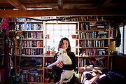 Marin City, April 6 2012 - Portrait of Alicia, one of the current tenants, inside her room in the Vallejo, a houseboat previously owned by Alan Watts.
