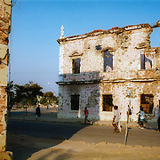 Kuito, Angola                                       September, 2002<br /> <br /> Bullet holes cover the provincial government buildings in Kuito, Angola. The 27-year civil war destroyed much of the infrastructure of Kuito. Photo by Lori Waselchuk/South Photographs