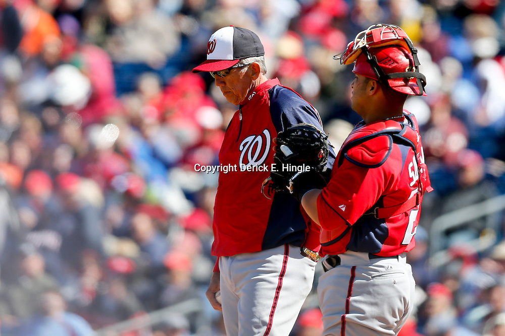 Mar 6, 2013; Clearwater, FL, USA; Washington Nationals manager Davey Johnson (5) talks with catcher Jhonatan Solano (23) during the bottom of the fourth inning of a spring training game at Bright House Field. Mandatory Credit: Derick E. Hingle-USA TODAY Sports