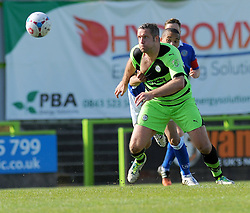 Macclesfield Town's Thierry Audel trees to hold off Forest Green Rovers's Jonathan Parkin - Photo mandatory by-line: Nizaam Jones - Mobile: 07966 386802 - 11/04/2015 - SPORT - Football - Nailsworth - The New Lawn - Forest Green Rovers v Macclesfield Town - Vanarama Football Conference