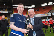 Broughty Athletic (blue) v North End (white) in the Signature Signs Inter-Regional Cup Final at Tannadice Park, Dundee; Broughty Athletic captain Graham Hay is presented with the trophy by East Region General Secretary John Reilly