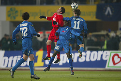 SOFIA, BULGARIA - Wednesday, March 3, 2004: Liverpool's Harry Kewell wins a header with Levski Sofia's Omonigho Temile (#26) and Elin Topuzakov during the UEFA Cup 4th Round 2nd Leg match at the Vasil Levski Stadium. (Pic by David Rawcliffe/Propaganda)