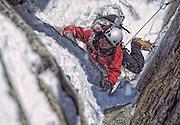 American mountaineer Nancy Feagin climbing a couloir in the French Alps near Chamonix France.