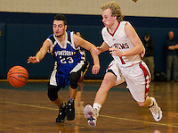 Winnisquam's Christian Serrano and Laconia's Jake Ellis go after a loose ball during the semi final round at the 42 annual Holiday Basketball Tournament Wednesday evening.  (Karen Bobotas/for the Laconia Daily Sun)