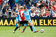 13-09-2015 VOETBAL:FEYENOORD-WILLEM II:ROTTERDAM<br /> Stijn Wuytens van Willem II in duel met Dirk Kuyt van Feyenoord <br /> <br /> Foto: Geert van Erven