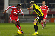 Chesterfield FC midfielder Gboly Ariyibi skips the ball past Burton Albion defender Damien McCrory during the Sky Bet League 1 match between Burton Albion and Chesterfield at the Pirelli Stadium, Burton upon Trent, England on 12 February 2016. Photo by Aaron Lupton.