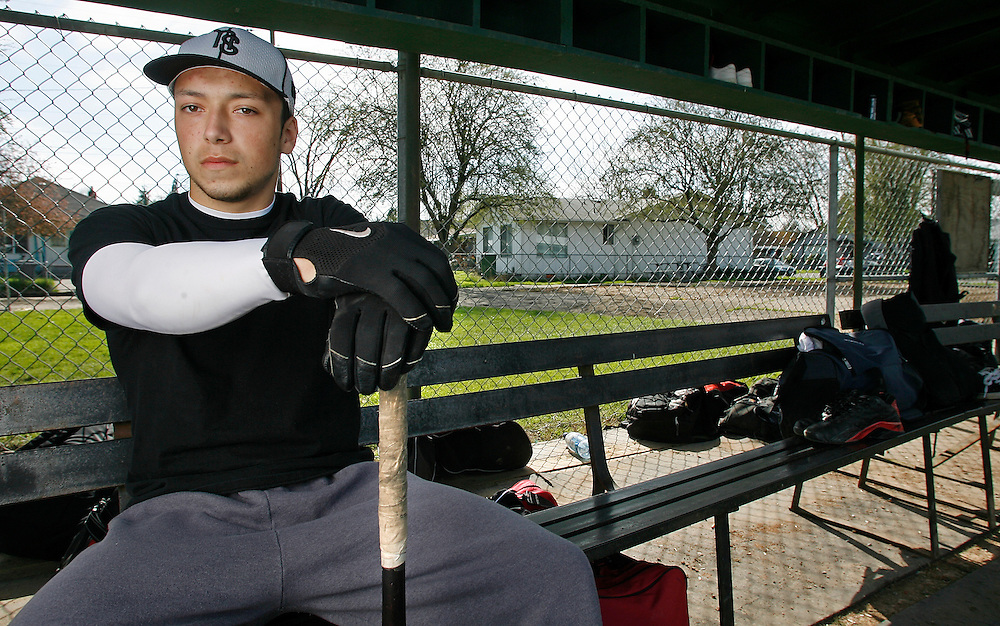 North Salem's Robbie Jackson is photographed in the dugout at Barrick Field.