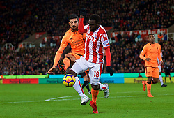 STOKE-ON-TRENT, ENGLAND - Wednesday, November 29, 2017: Liverpool's Emre Can and Stoke City's Mame Diram Diouf during the FA Premier League match between Stoke City and Liverpool at the Bet365 Stadium. (Pic by David Rawcliffe/Propaganda)