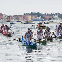 "VENICE, ITALY - SEPTEMBER 04:  Seven ""Gondolini"" teams  take part in the most important race of the Historic Regata on September 4, 2011 in Venice, Italy. The Historic Regata is the most popular boat race on the Gran Canal for locals and tourists alike."