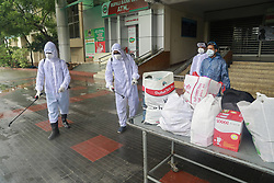 Hospital workers disinfect bags as the discharged COVID-19 patients leave the Mugda Medical College and Hospital in Dhaka, Bangladesh, May 2, 2020. As many as 540 doctors have contracted Covid-19 in the country so far, accounting for a little over 6.5% of the total infections reported in the country till Friday when the number of cases climbed to 8,238. Photo by Suvra Kanti Das/ABACAPRESS.COM