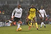 Fulham defender Denis Odoi (4) and Burton Albion striker Lucas Akins (10) during the EFL Sky Bet Championship match between Fulham and Burton Albion at Craven Cottage, London, England on 20 January 2018. Photo by Richard Holmes.