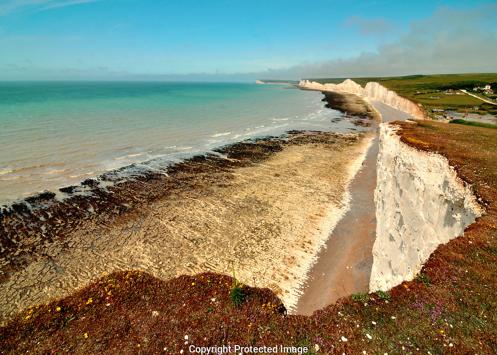 The Seven Sisters are a series of chalk cliffs by the English Channel. They form part of the South Downs in East Sussex, between the towns of Seaford and Eastbourne in southern England.